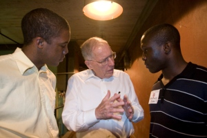 From left, Anthony Britt '10, William Winter, Former Governor of Mississippi and Sumorwuo Zaza, '11 talk together after Winter spoke to the Alternative Spring Break students in Jackson, Mississippi. Staff Photo: Kris Snibbe/Harvard News Office